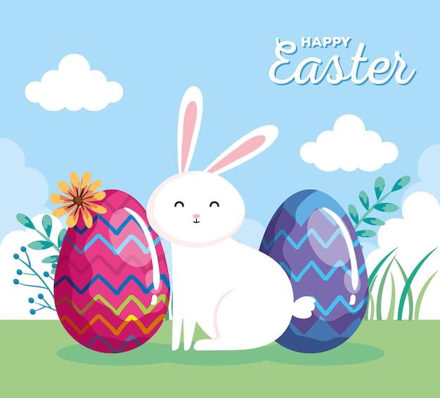 Carta di pasqua felice con coniglio e le uova nel paesaggio