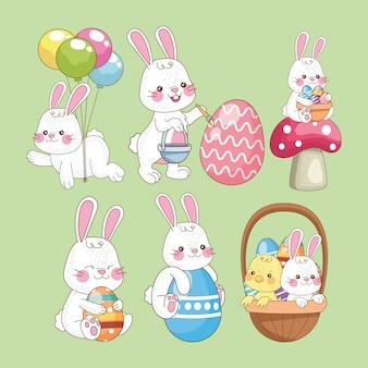 Carta di pasqua felice con il gruppo dei conigli
