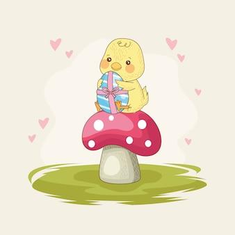 Carta di pasqua felice con il pulcino del bambino con la pittura dell'uovo nel fungo