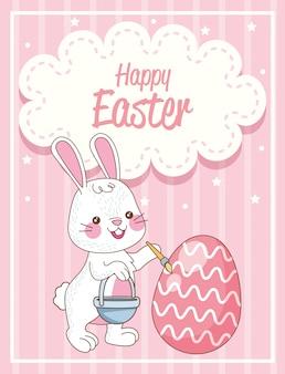 Carta di pasqua felice con l'uovo della pittura del coniglio