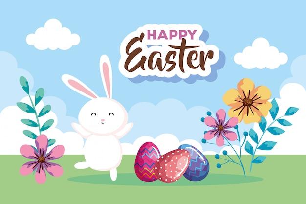 Carta di pasqua felice con le uova decorate e coniglio