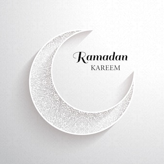 Carta di ramadan kareem. luna ornamentale bianca con ombra e scritta nera ramadan kareem su sfondo chiaro.