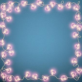Carta di san valentino con luci incandescenti a forma di cuore.