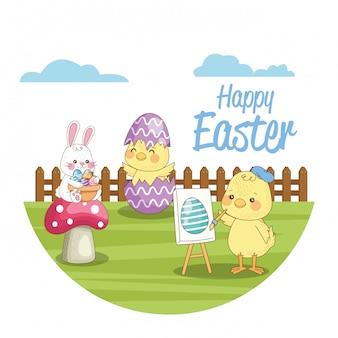 Carta stagionale felice di pasqua con i pulcini e coniglio nel campo