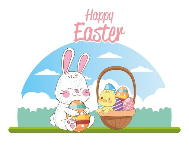 Carta stagionale felice di pasqua con la merce nel carrello del coniglio e del pulcino