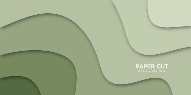 Carta tagliata verde con forme ondulate eleganti astratte.