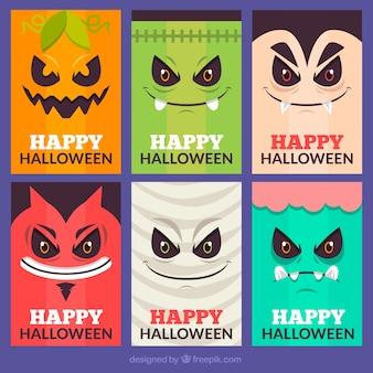 Carte di halloween con facce mosnters