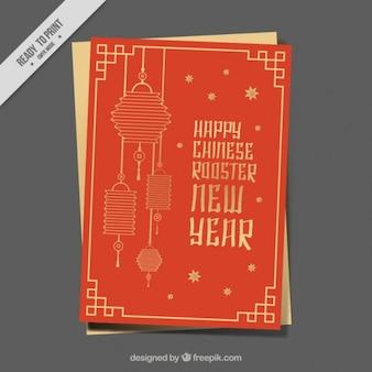 Cartellino rosso e oro per l'anno gallo