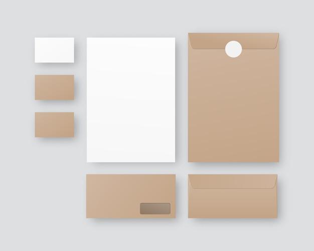 Cartoleria aziendale con buste, carta, biglietti da visita. insieme di modelli di identità corporativa. su sfondo grigio.