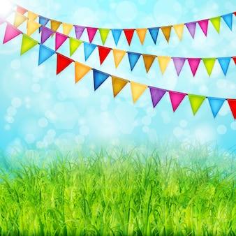 Cartolina d'auguri con bandiere colorate e vettore di erba verde