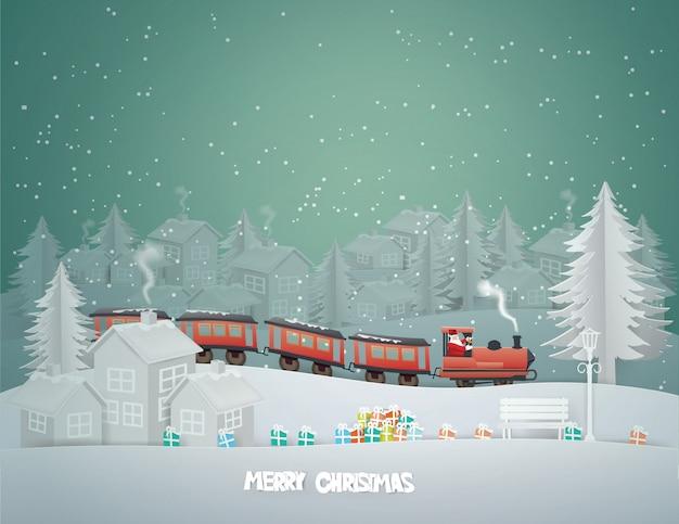 Cartolina d'auguri di buon natale con babbo natale che guida il treno fino alla città di campagna urbana nella stagione invernale.