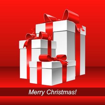 Cartolina d'auguri di buon natale con scatola regalo bianca e fiocco in nastro rosso