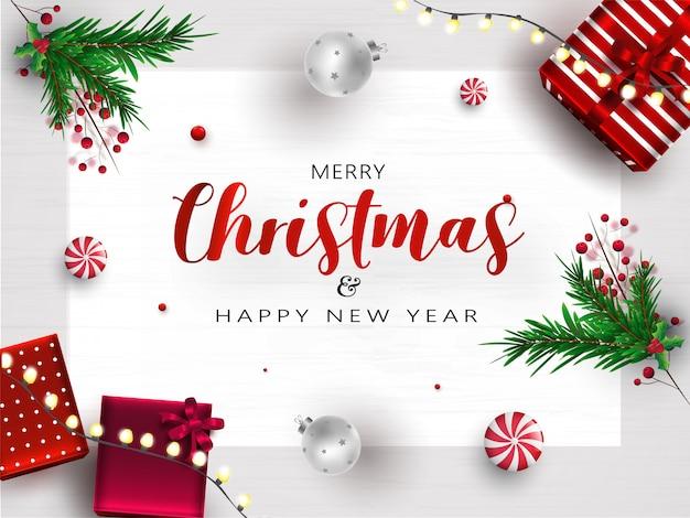 Cartolina d'auguri di buon natale e felice anno nuovo con vista dall'alto di scatole regalo, palline, foglie di pino, bacche e ghirlanda di illuminazione decorato su struttura di legno bianco.