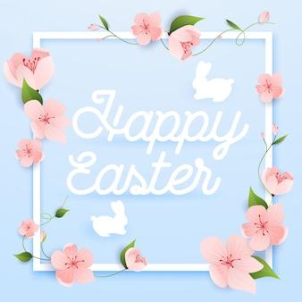 Cartolina d'auguri di buona pasqua con fiori e coniglio.