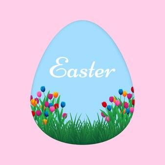 Cartolina d'auguri felice variopinta di pasqua con le uova ed i fiori