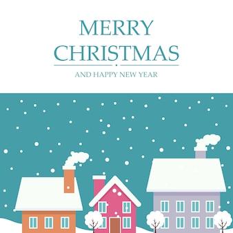 Cartolina di natale allegro con case nella neve d'inverno