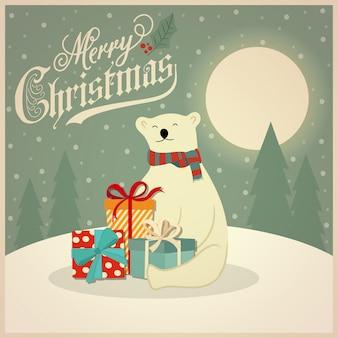 Cartolina di natale con orso polare e scatole regalo