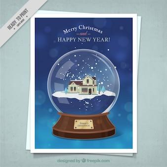Cartolina di natale di palle di neve con una bella casa