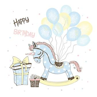 Cartolina per la nascita di un ragazzo con un cavallo giocattolo unicorno e palloncini e regali.