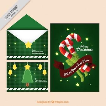 Cartoline busta e di natale con bastoncini di zucchero e stelle