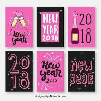 Cartoline d'auguri di nuovo anno in rosa e nero