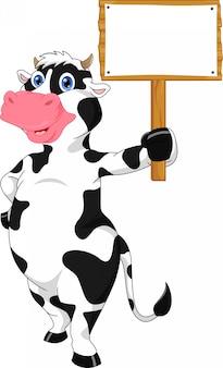 Cartone animato carino mucca e segno bianco