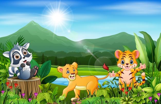 Cartone animato del bellissimo paesaggio con diversi animali