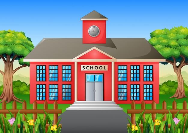 Cartone animato dell'edificio scolastico con cortile verde