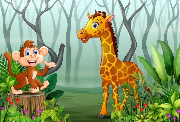 Cartone animato di scimmia e giraffa nella foresta nebbiosa