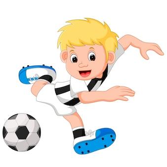 Cartone animato felice ragazzo a giocare a calcio