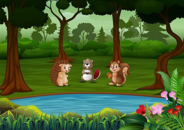 Cartone animato molti animali nella foresta