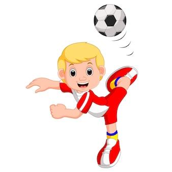 Cartone animato ragazzo a giocare a calcio