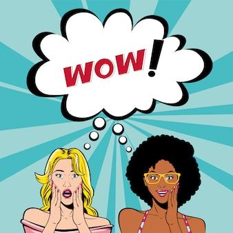 Cartoni animati di donne retrò capelli afro e biondi con wow bolla vettoriale