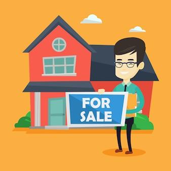 Casa d'offerta del giovane agente immobiliare asiatico.