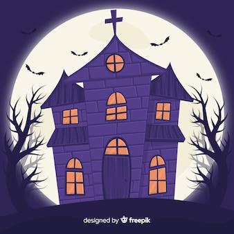 Casa di halloween piatta e luna piena dietro di essa