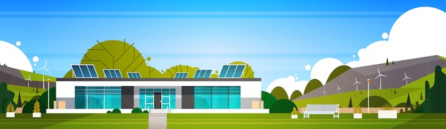 Casa moderna amichevole di eco con le turbine eoliche ed i pannelli solari concetto di energia alternativa orizzontale
