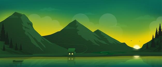Casa sul lago sullo sfondo panoramico delle montagne.
