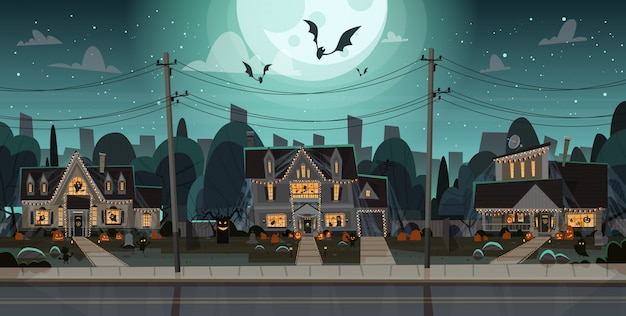 Case decorate per halloween, vista frontale con zucche diverse