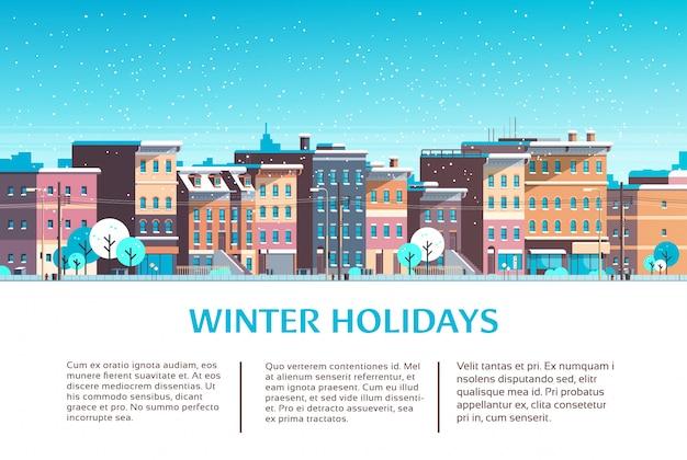 Case di costruzione della città paesaggio urbano di strada invernale per le vacanze di natale