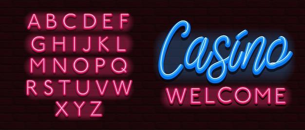 Casinò al neon della parete di mattoni del carattere di alfabeto della fonte tipografica