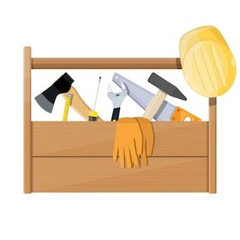 Cassetta degli attrezzi in legno piena di attrezzatura per l'edilizia