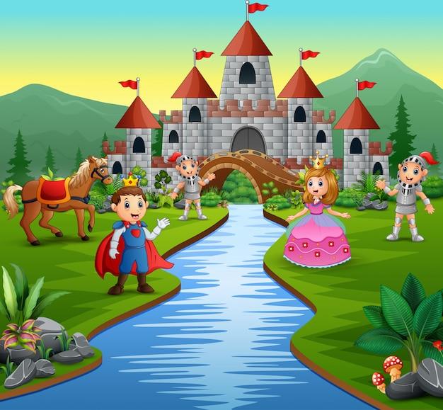 Cavaliere con principessa e principe in un paesaggio castello