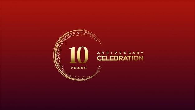 Celebrazione dell'anniversario con cifre d'oro nello scintillio dorato.