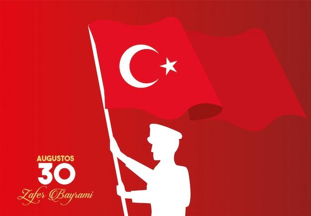 Celebrazione di zafer bayrami con soldato sventolando bandiera