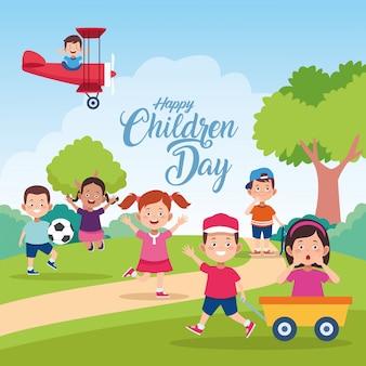 Celebrazione felice di giorno dei bambini con i bambini che giocano nel campo