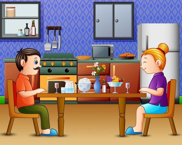 Cena in famiglia sul tavolo della cucina con papà mamma