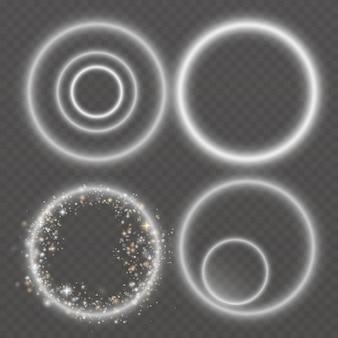 Cerchi di luce. luci e scintille. luci bianche astratte isolate su un trasparente