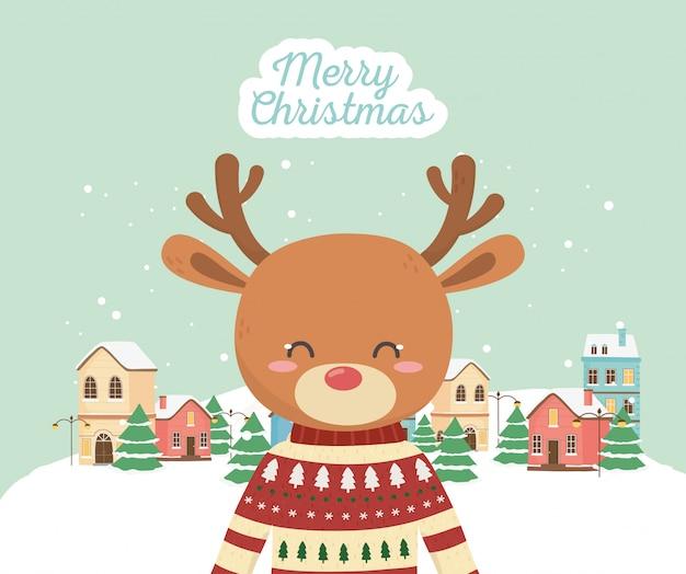 Cervi svegli di celebrazione di buon natale con la neve della città del maglione