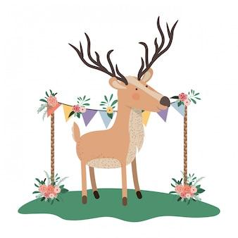 Cervo carino e adorabile con cornice floreale