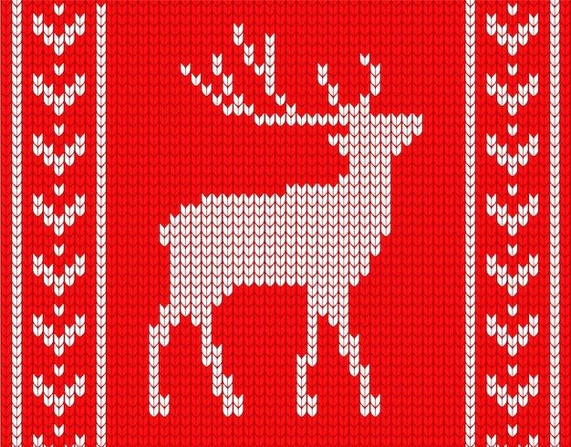 Cervo lavorato a maglia con motivi ai lati. nello stile del maglione lavorato a maglia.